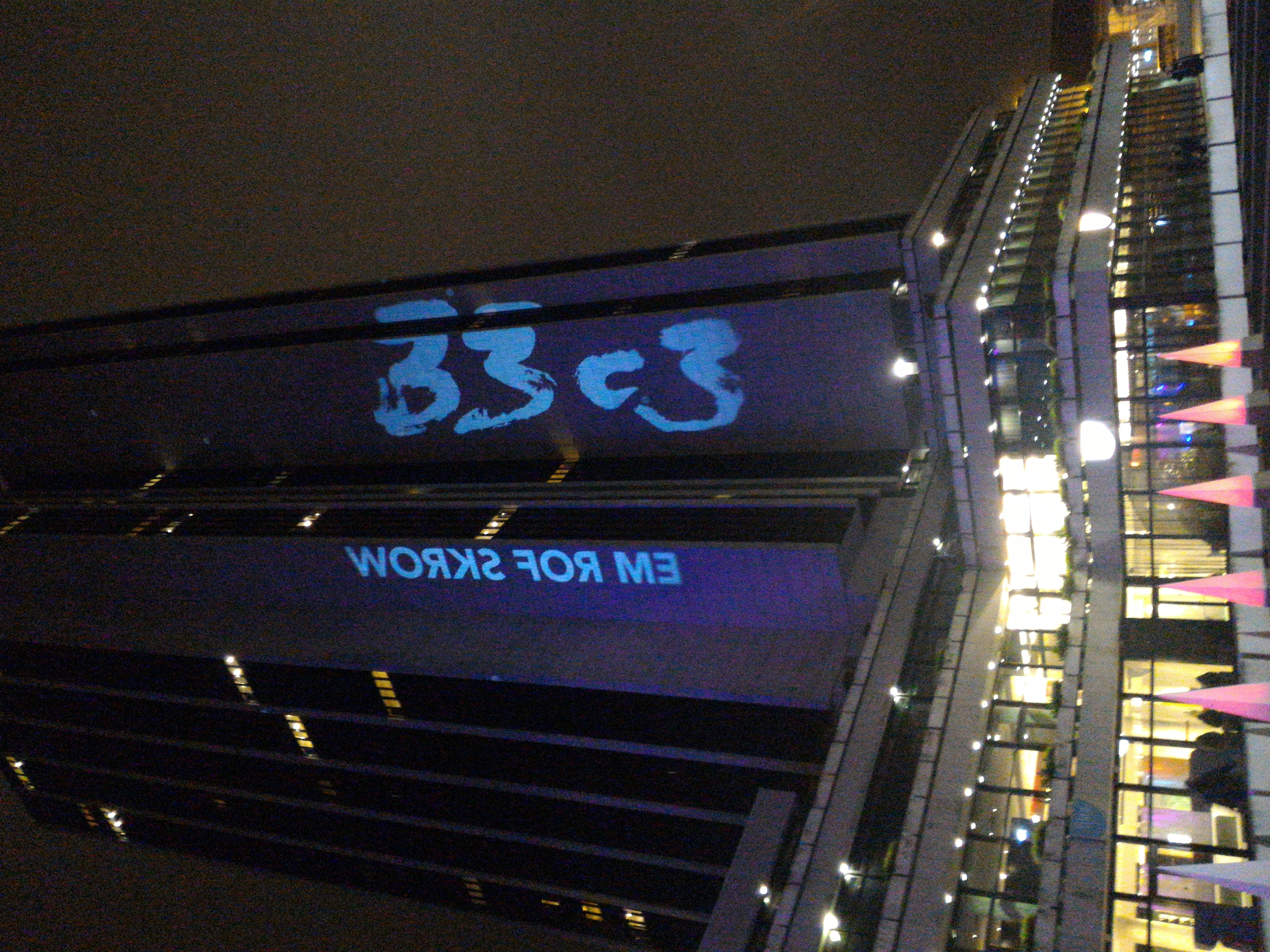light logo of 33C3 on the building